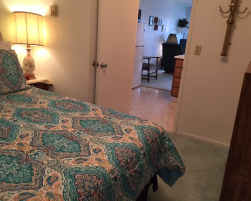 109B-Bed-Looking-into-Living-Room